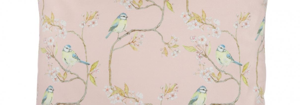 Blue tit on blossom pink cotton cushion